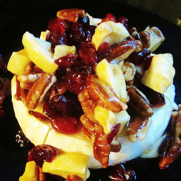 baked brie with caramel pecan, cranberry. and apples
